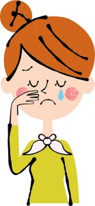 痛みで泣いている女性